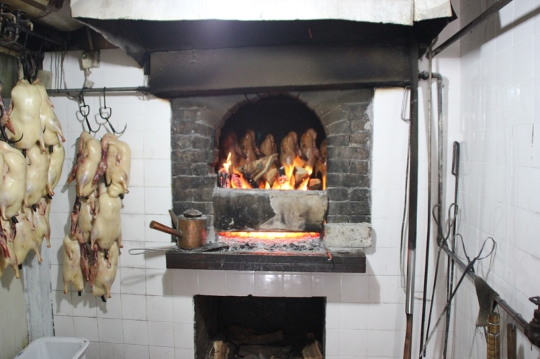Ducks being roasted in the fruit wood oven